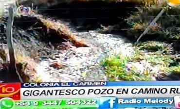 COLONIA EL CARMEN POZO GIGANTE EN CAMINO RURAL.